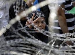 A peace sign amid the barb wire