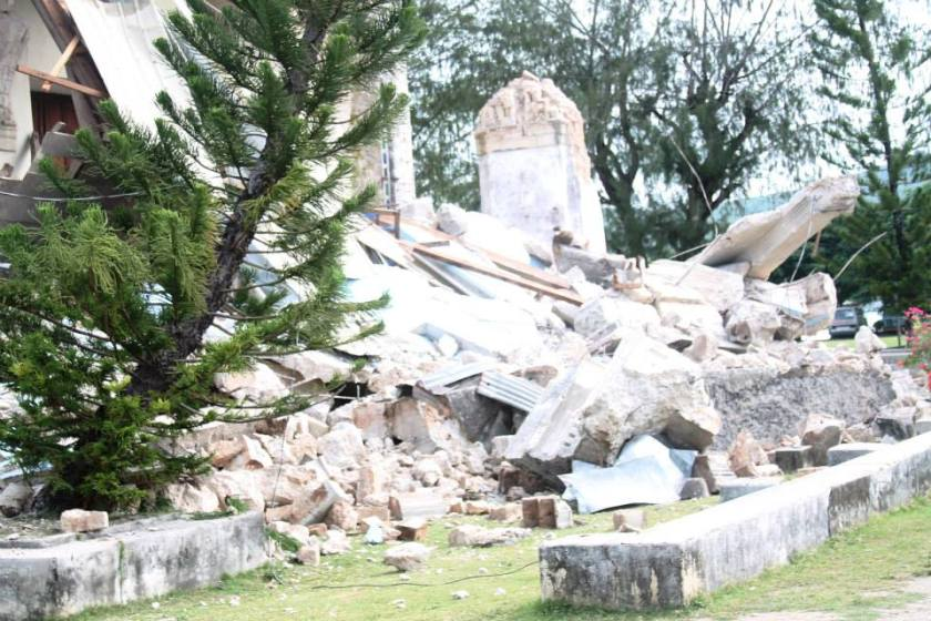 The damaged Dauis Church
