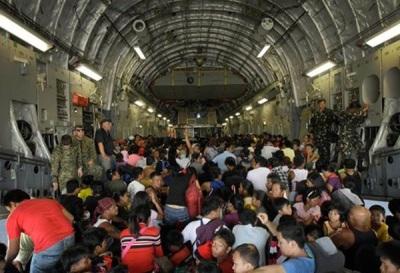 Evacuees preparing for the plane trip to Manila or Cebu.