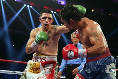 Nearing the end, Rios' eyes could hardly see. (Photo by bleacherreport.com)