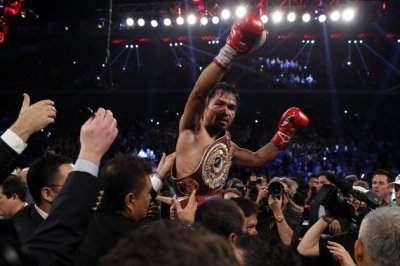 Manny scores in a one-sided boxing lesson of a match. (Photo by sports.yahoo.com)