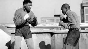 Mandela showing off his boxing skills.