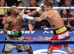 Mayweather had a difficult time with Marcus Maidana in their first bout. (Courtesy of  ibtimes.com)