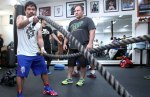 Manny works out with Justin Fortune.