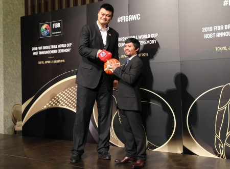 China 2019 Ambassador and former basketball star Yao Ming, left, and Philippine Congressman and eight-time world boxing champion Manny Pacquiao pose for a photo ahead of FIBA's announcement on whether the Philippines or China will host the 2019 Basketball World Cup, in Tokyo, Friday, Aug. 7, 2015. (AP Photo/Koji Sasahara)