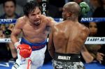 In the second bout, a more focused Pacquiao pressed the attack...