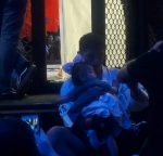 Its over. A thankful Hideo cuddles his young daughter after the fight...