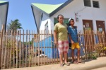 Shirley Elladora's kids before their home in Aguho.