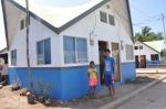 Felisa Amistoso's children pose before their brand-new home.