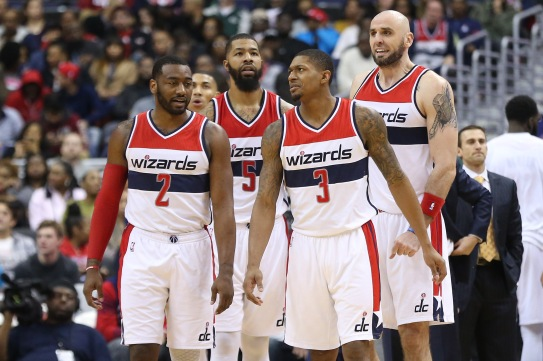Jan 6, 2017; Washington, DC, USA; Washington Wizards guard John Wall (2), Wizards guard Bradley Beal (3), Wizards forward Markieff Morris (5), and Wizards center Marcin Gortat (13) stand on the court against the Minnesota Timberwolves in the third quarter at Verizon Center. The Wizards won 112-105. Mandatory Credit: Geoff Burke-USA TODAY Sports