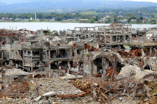 Damaged buildings and houses are seen in Marawi city