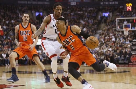 Mar 28, 2016; Toronto, Ontario, CAN; Oklahoma City Thunder guard Russell Westbrook (0) drives to the net past Toronto Raptors guard DeMar DeRozan (10) as Oklahoma City center Steven Adams (12) looks on during the first half at the Air Canada Centre. Mandatory Credit: John E. Sokolowski-USA TODAY Sports