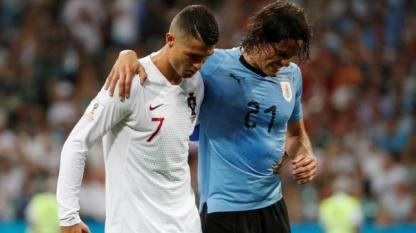 - In a mark of sportsmanship, Ronaldo helps an injured Cavani off the field. (India Today)