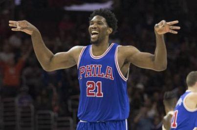 Joel Embid celebrates a '3'. (Black Sports Online)