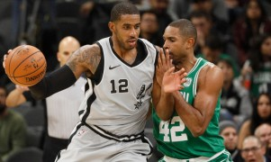 Lamarcus Aldridge and Al Horford battle it out. (Hoops Hype)