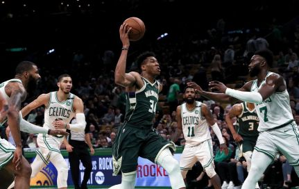 Giannis punches thru the defense. (The Boston Globe)