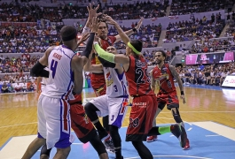 Paul Lee gets smothered by the giants.