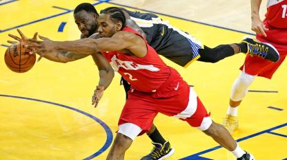 heated battle for the loose ball. (The National)